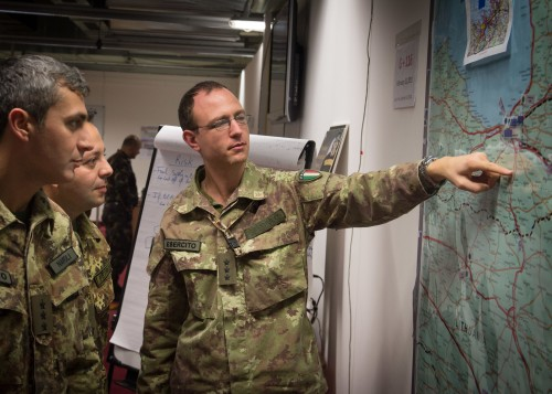 """Italien Soldiers working on the Map during Exercise Trident Lance 2014 in Grafenwoehr, Germany.  TRLE 14 is an Allied Command Transformation (ACT) sponsored event designed to train, exercise and evaluate Land Command (LANDCOM) as the Land Component Command Headquarters (LCC) for Joint Force Command Naples.  As LCC, LANDCOM will command multiple NATO Corps Hqs conducting full spectrum operations in an environment larger than Major Joint Operations, involving high intensity  combat operations."""