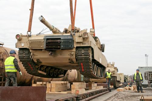 The first Abrams M1A2 tank for the 2-7 Infantry Battalion, 1st Armored Brigade Combat Team, 3rd Infantry Division is unloaded onto Lithuanian soil after a 5,000-mile trip from Fort Benning, Ga. Soldiers from the battalion are rotating into the Baltic states in support of Operation Atlantic Resolve to ensure partnership and security for NATO allies in the Eastern Europe. (U.S. Army photo by Sgt. Brandon Hubbard, 204th Public Affairs Detachment/Released)