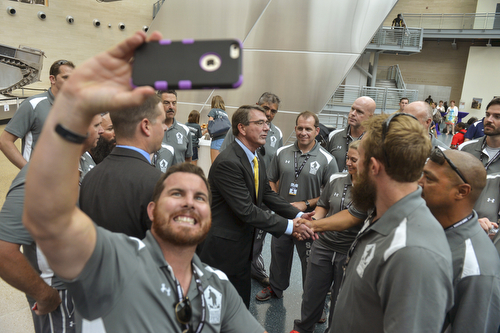Members of Team Southcom gather around Secretary of Defense Ash Carter  during a reception held after the opening ceremony of the 2015 Defense Department Warrior Games at the National Museum of the Marine Corps in Quantico, Va., June 19, 2015. DoD Photo by Glenn Fawcett (Released)