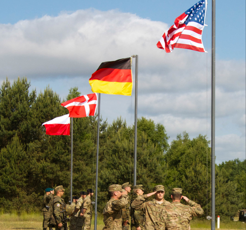 U.S., Polish, German and Danish soldiers raise country flags at the opening ceremony of Saber Strike 15, a multinational training exercise, June 8, 2015, at the Drawsko Pomorskie Training Area in Poland. Saber Strike is a long-standing U.S. Army Europe-led cooperative training exercise. This year's exercise objectives facilitate cooperation amongst the U.S., Estonia, Latvia, Lithuania, and Poland to improve joint operational capability in a range of missions as well as preparing the participating nations and units to support multinational contingency operations. There are more than 6,000 participants from 13 different nations. (U.S. Army photo by Spc. Marcus Floyd, 13th Public Affairs Detachment)