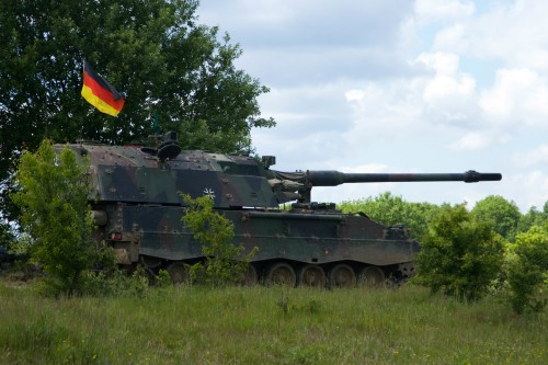 A German Panzerhaubitze 2000 awaits orders from the fire direction center June 11, 2015 at the Drawsko Pomorskie Training Area in Poland as German and U.S. artillery and mortar units train together during Saber Strike 15, a long-standing U.S. Army Europe-led cooperative training exercise. This year's exercise takes place across Estonia, Latvia, Lithuania, and Poland, and is designed to improve joint operational capability in a range of missions as well as preparing the participating nations and units to support multinational contingency operations. There are more than 6,000 participants from 13 different nations. (U.S. Army photo by Spc. Marcus Floyd, 13th Public Affairs Detachment)