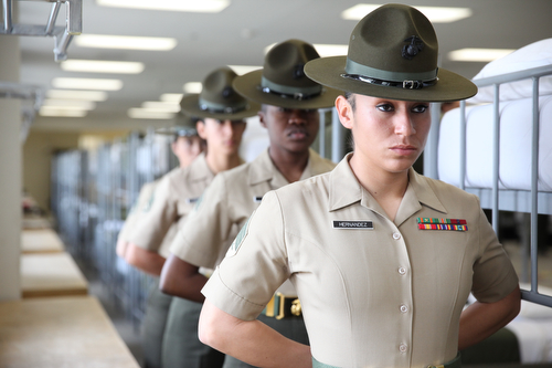 U.S. Marine drill instructors with 4th Recruit Training Battalion, Recruit Training Regiment, Marine Corps Recruit Depot Parris Island stand at parade rest as they wait to give a demonstration of what recruits encounter during pick-up week, the first week of recruit training, during the 70th anniversary of women in the Marine Corps aboard Marine Corps Recruit Depot Parris Island, S.C., March 1, 2013. The celebration was in acknowledgement of the seventy years of continuous service by women in the Marine Corps. (U.S. Marine Corps photo by Cpl Aneshea S. Yee/Released)