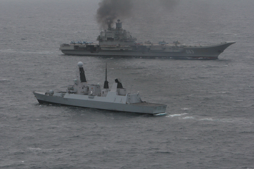 HMS Dragon (foreground) with the Russian aircraft Carrier 'Admiral Kuznetsov'. A Royal Navy warship has tracked and met up with a Russian task group off the coast of Brest as they entered the English Channel on Wednesday to sail north. HMS Dragon, a Type 45 Destroyer and one of the Royal Navy's most technically advanced warships, was able to pinpoint and monitor the movement of the seven-strong group led by Russian aircraft carrier Admiral Kuznetsov as it approached the UK