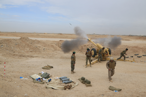 Afghan National Army soldiers fire a 122mm Howitzer 2A18 (D-30)